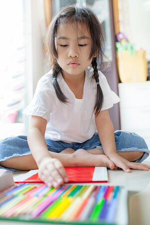 Child learning at home in the living room
