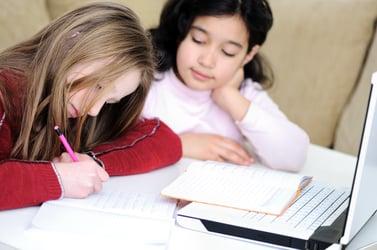 girls writing an essay
