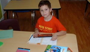 Math Genie Student Working on the Abacus