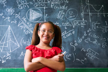 graphicstock-concepts-on-blackboard-at-school-young-people-students-and-pupils-in-classroom-smart-hispanic-girl-writing-math-formula-on-board-during-lesson-portrait-of-female-child-smiling-looking-at-camera_B9fbtojDvW