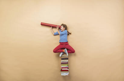graphicstock-happy-girl-is-playing-with-group-of-books-in-studio_rR5wO1hbW