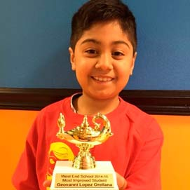 """Math Genie student awarded the """"Most Improved Student""""award from his school. His Dad credits Math Genie for a dramatic turnaround in his child."""